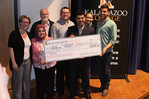 The three winners of the 2013 Global Prize